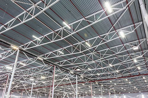 Energy efficient lighting in a warehouse focus on ceiling